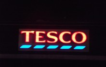 Struggling retailer Tesco announces drop in profits